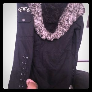 Awesome stitched up sleeved coat